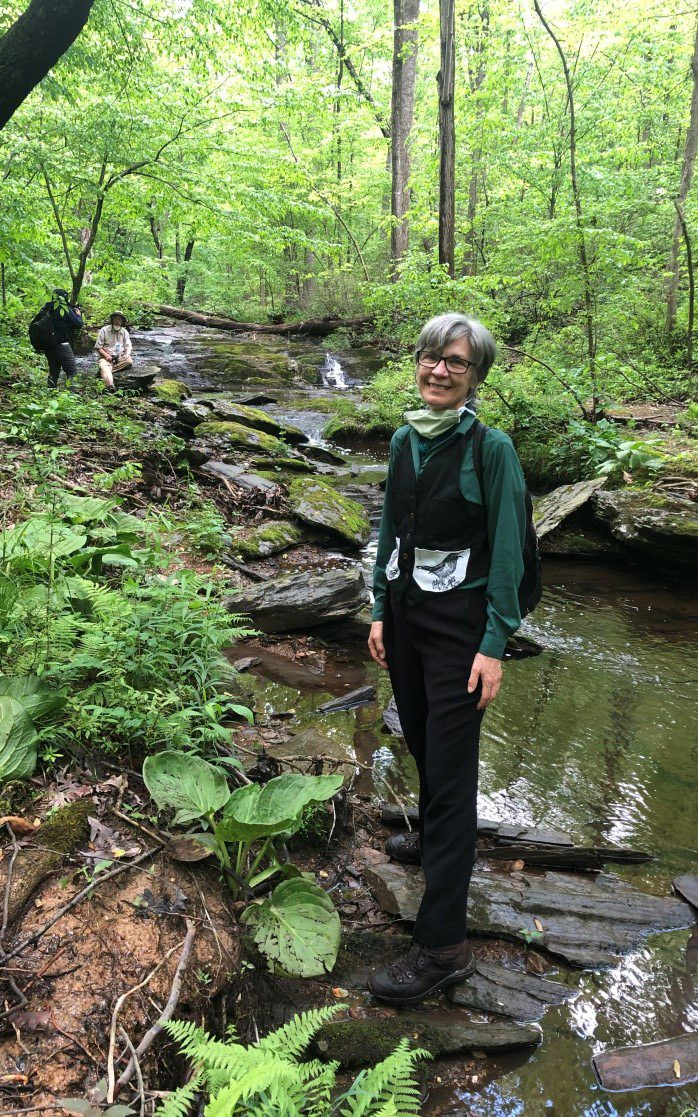 Caption:  Diane Cameron at Dayspring Creek, May 2020.  In the background are filmmaker Dial Keju, and Dr. Jim Hall.